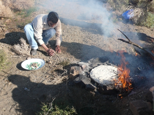 bread-cooking-on-rocks-with-fire