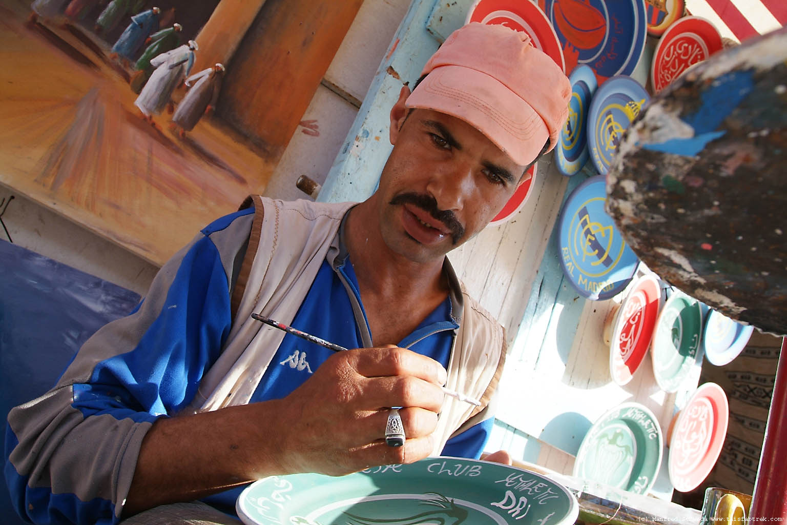 man-painting-pottery