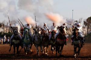 Horse riders perform with guns during the El-Jadida International Horse Show in El-Jadida